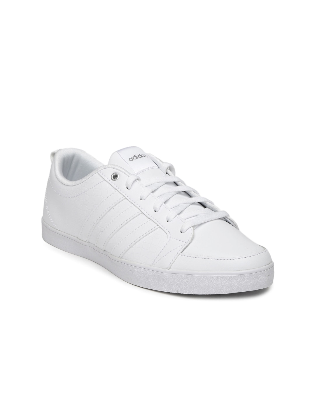 White sneakers are taking over the sidewalks and show the athleisure trend has no plans of slowing down. Shop our favorite white sneakers from brands like Adidas, Superga, and Keds.