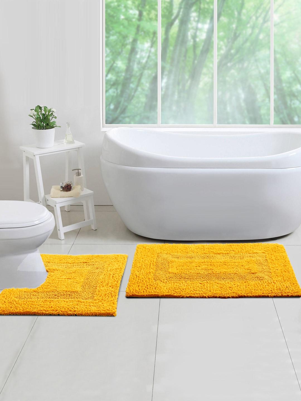 Blue and brown bathroom rugs