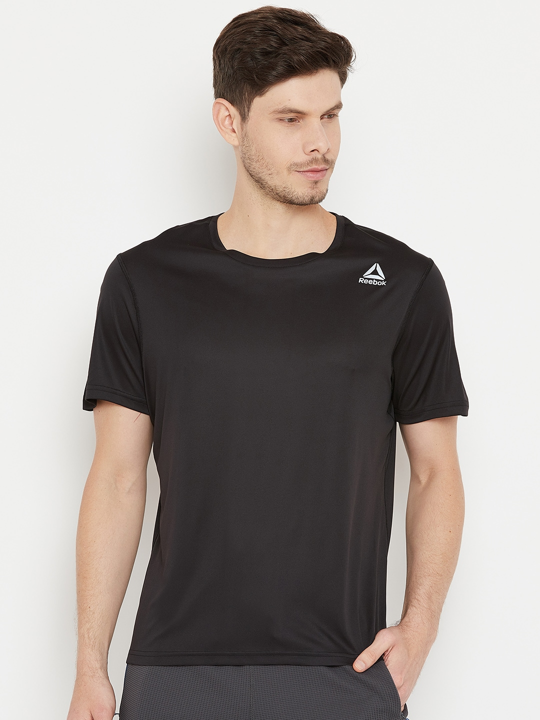 3b182605 Reebok Men Black Solid Round Neck Running T-shirt