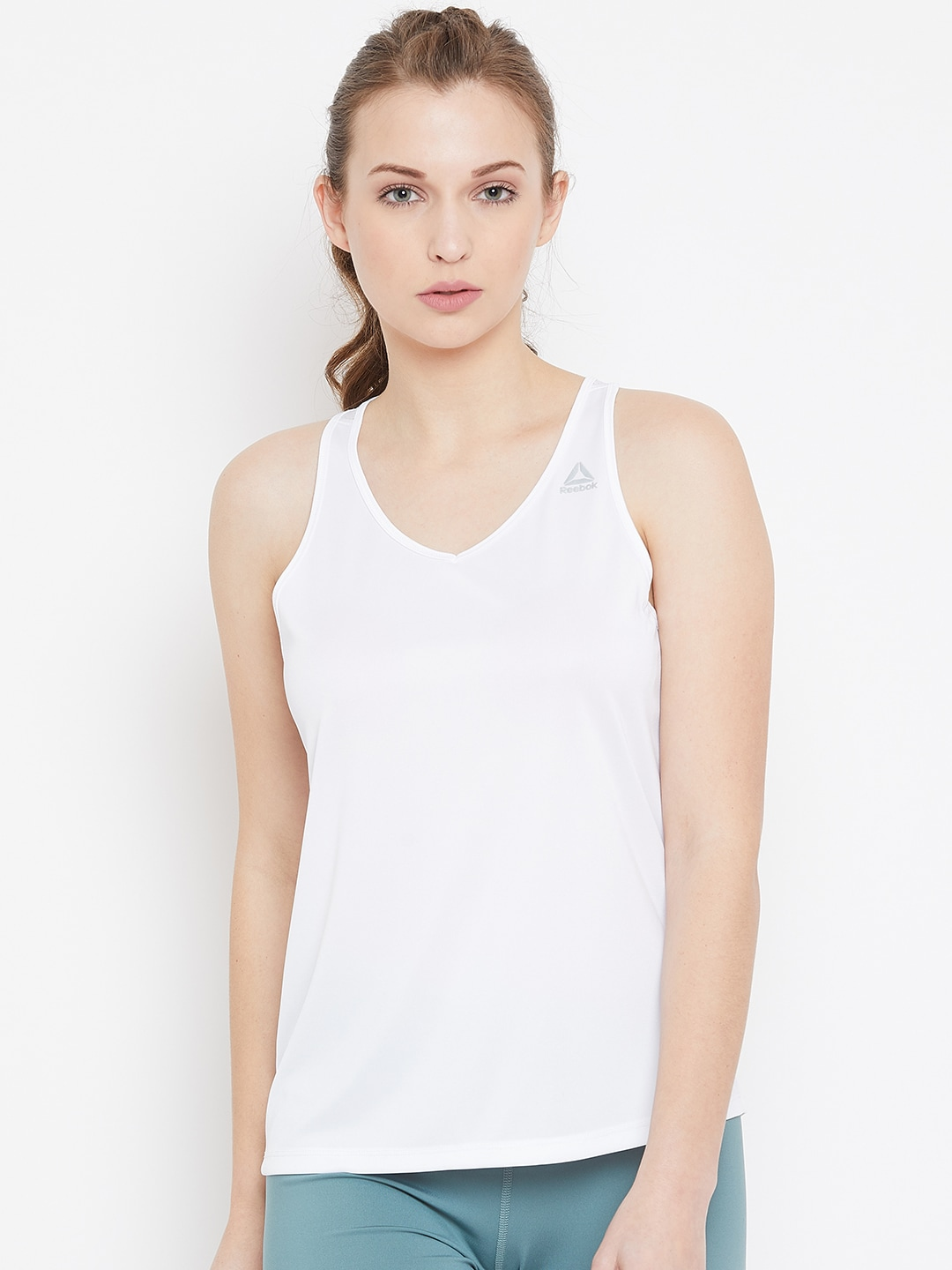 61a62c00 Reebok Women White Solid Tank Top