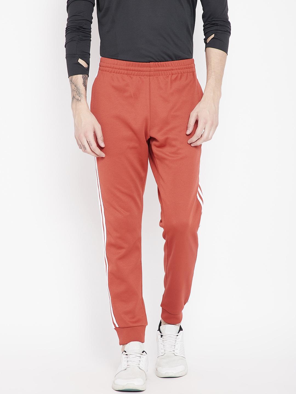 ADIDAS Originals Men Rust Orange Solid Slim Fit SST Joggers