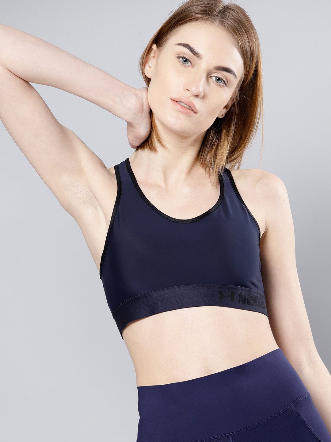 0e43301479 UNDER ARMOUR Women Navy Blue Solid Mid MDN Sports Bra 1273504-412