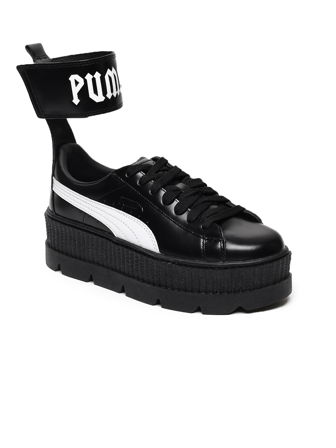 newest 77cad f9680 Puma Women Black Solid Leather High-Top Sneakers