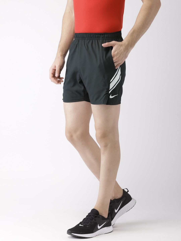 01fac3e80f8 Nike Men Black Solid Standard Fit DRY SHORT 7IN Tennis Shorts