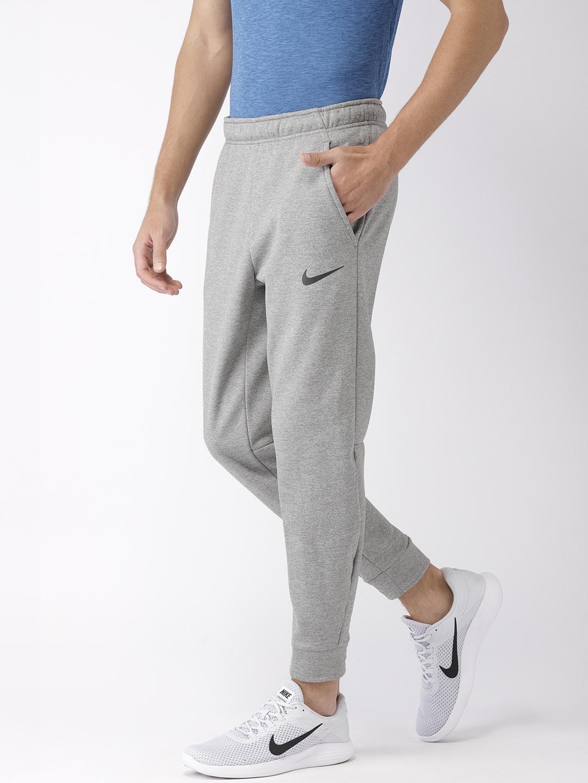 Nike Men Grey Solid Standard Fit THRMA DRI,FIT Technology Joggers