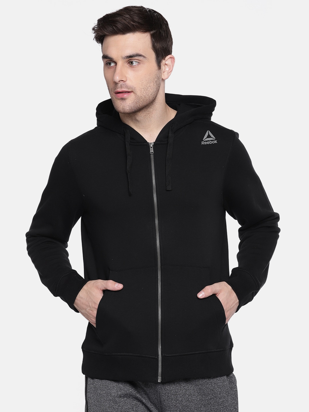 17b1fc12 Reebok Men Black Solid Hooded TE FLEECE FZ Sweatshirt