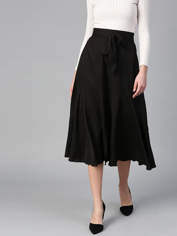 48f79e42ffb Bitterlime Women Black Solid Midi A-line Skirt