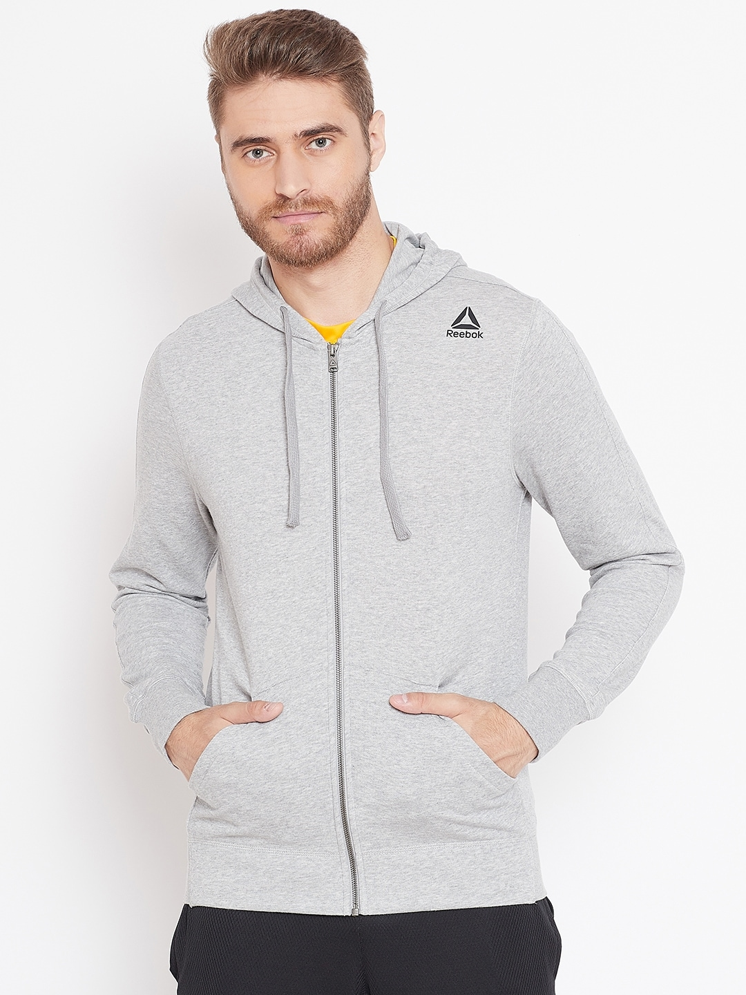 7bc966d2 Reebok Men Grey Melange Solid Training Essentials FZ Hooded Sweatshirt