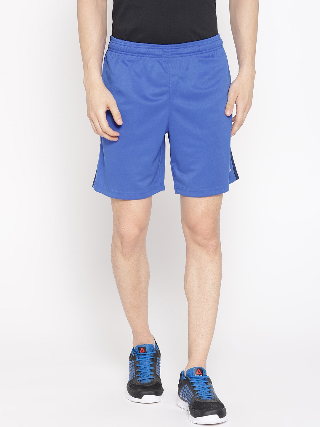 138fe3e780 Reebok Men Blue Solid Training Foundation Knit Shorts