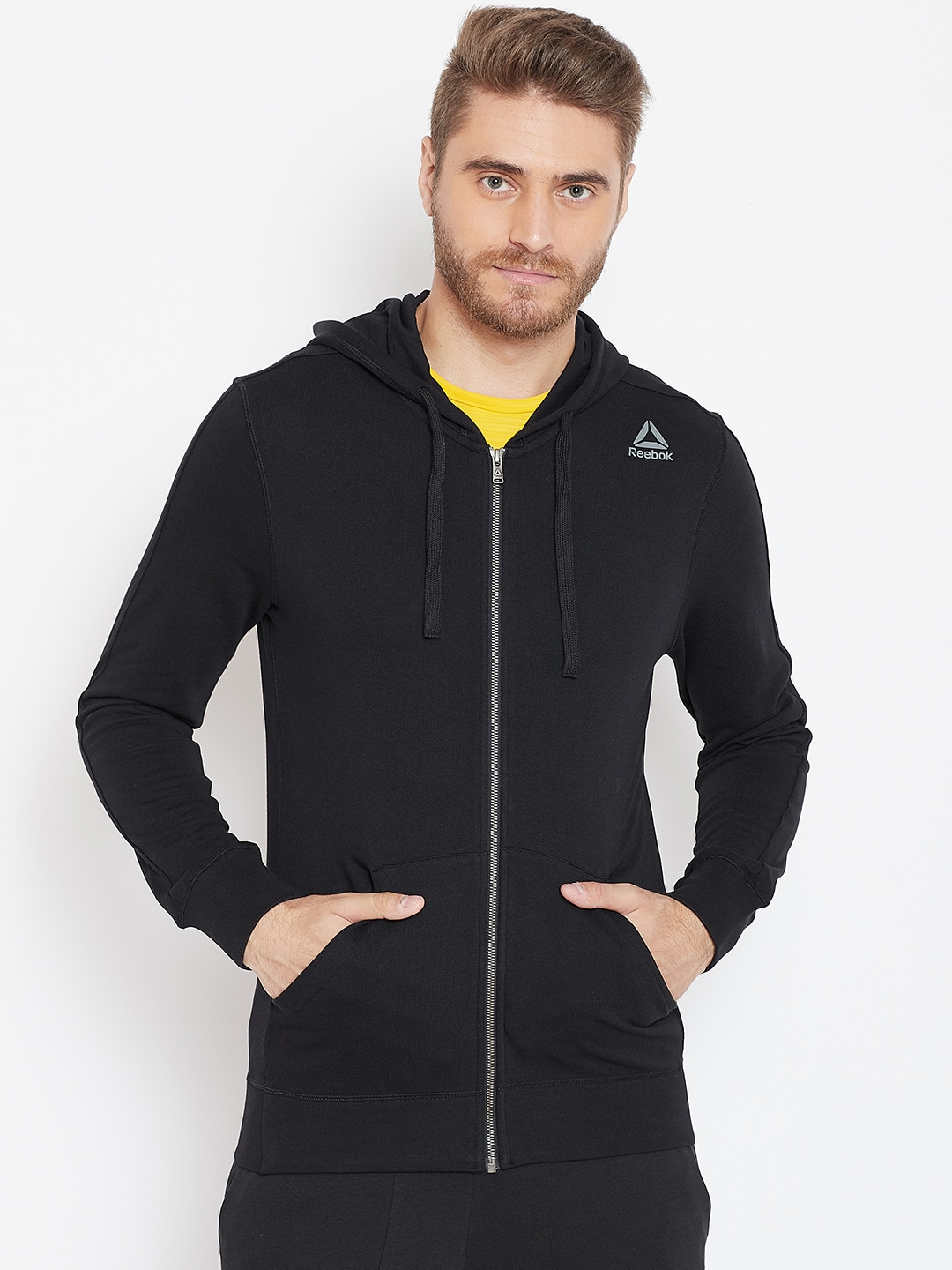 3a576b18 Reebok Men Black Solid Training Essentials FZ Hooded Sweatshirt