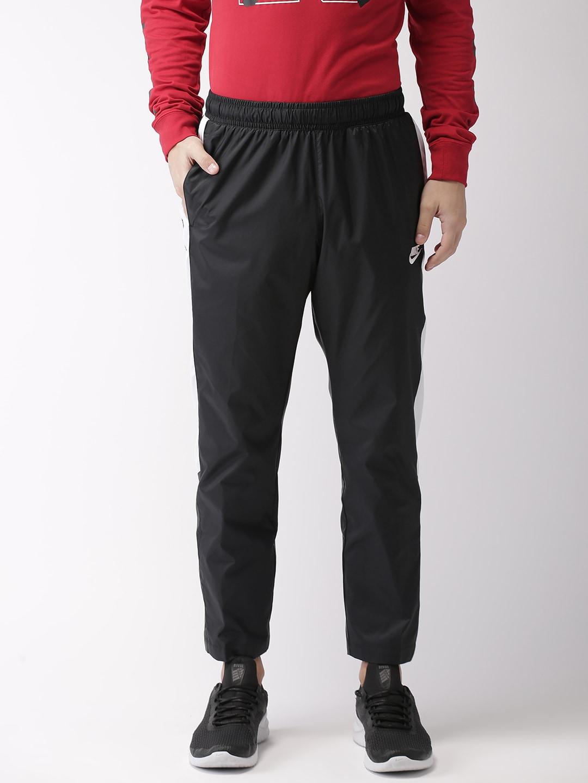a9e8bbe569bd Nike Track Pants Men - Buy Nike Track Pants Men online in India