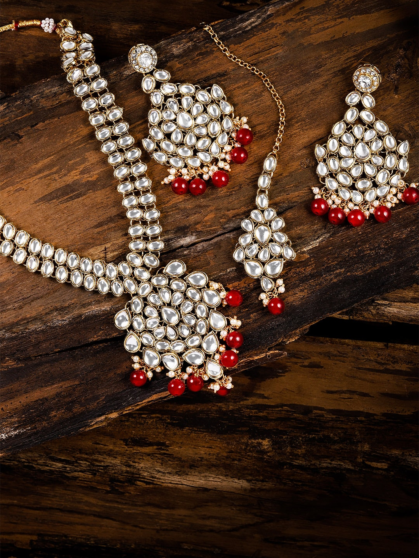 3c5e69292e945 Zaveri Pearls Gold Toned & Red Kundan Jewellery Set