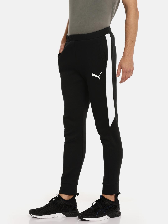 70624c044 Puma Men Black Solid Evostripe Core Slim Fit Track Pants Puma Track Pants