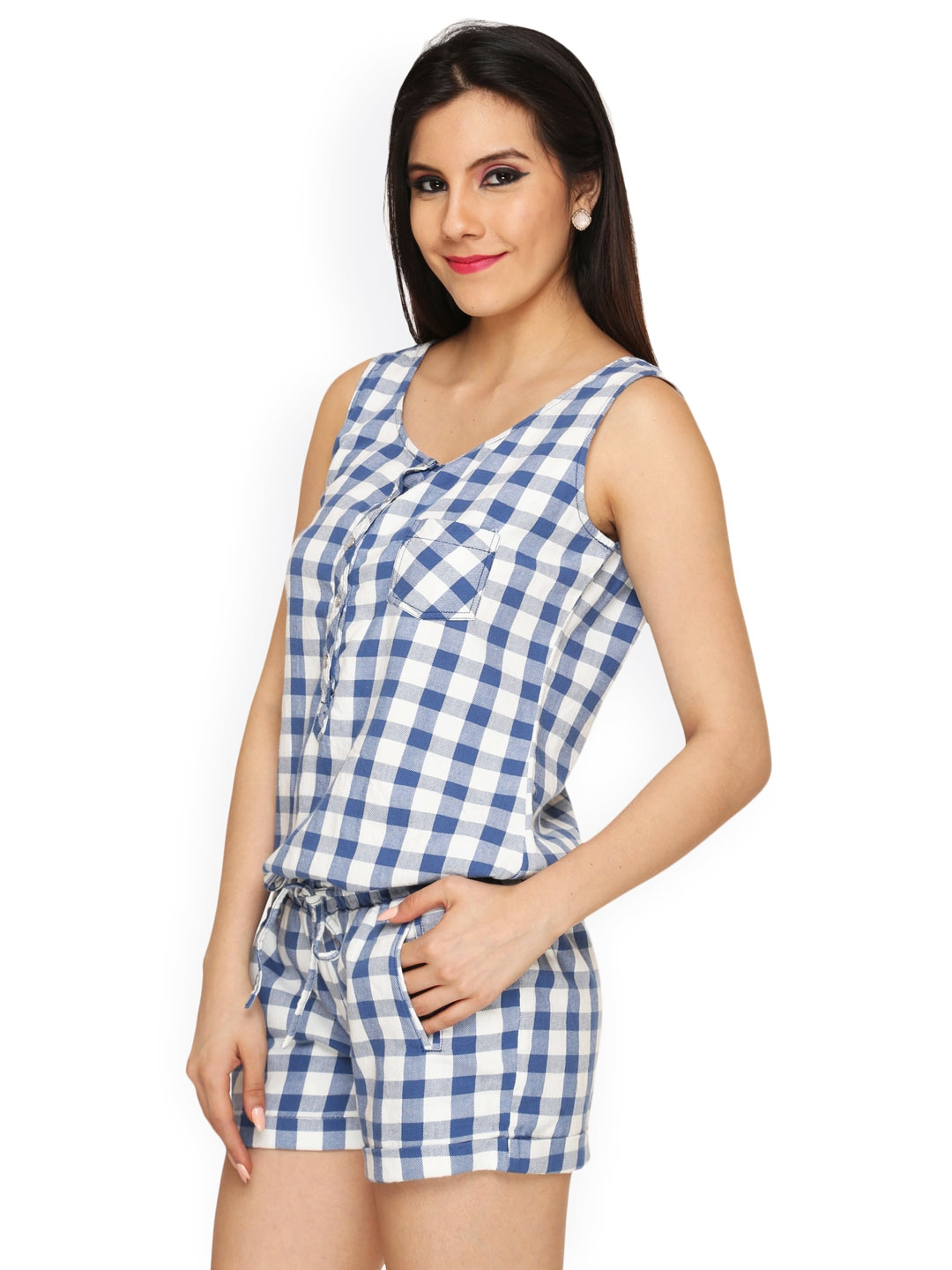 If there is one trend that remains unshakably strong this season, it's menswear-inspired checked tailoring. Our checked playsuit features long sleeves with elastic cuffs, alluring shoulder cutouts with frill detail and two side slant pockets.