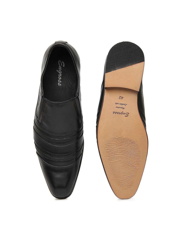 myntra engross black fila leather semi formal shoes