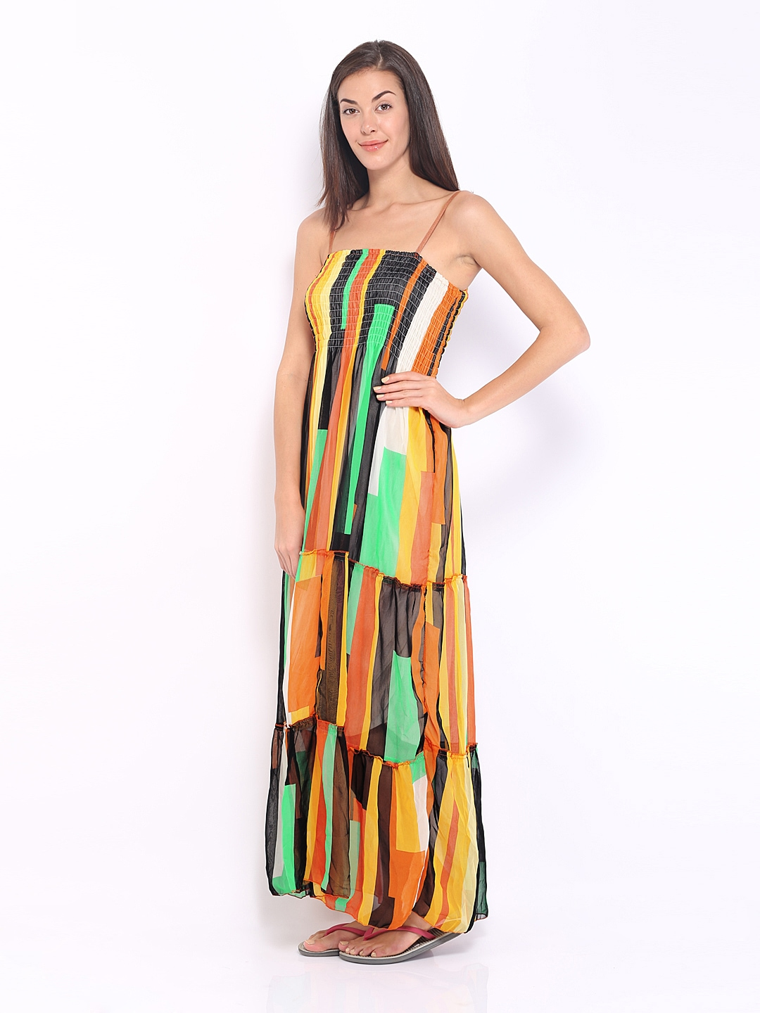 Multicolored Maxi Dress - Attend a beach party wearing our Multicolored Maxi Dress featuring a scoop neckline and a cutout back. Style with our dangling earrings/5(4).