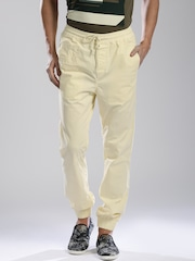 HRX by Hrithik Roshan Men Cream-Coloured Solid Regular Fit Cuffed Trousers
