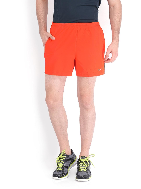 ecc1d3079c5 Buy Nike Men Orange Running Shorts 9499850 for men online in ...