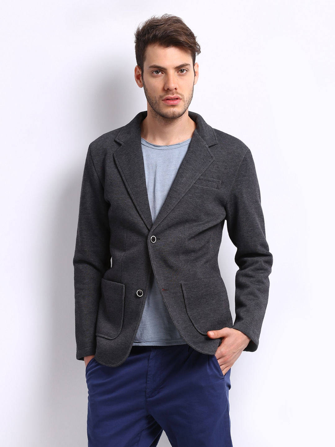 Dark Grey Blazer. Although grey is often seen as a lighter alternative, a dark grey suit can be just as versatile as black. The darker shade means that it will work well with a wider range of items. Try teaming a dark grey blazer with a black turtleneck sweater and some matching trousers for a formal look that works in multiple seasons.