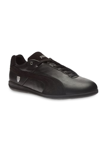 PUMA Men Black Leather Sneakers at myntra