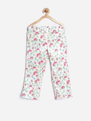 United Colors of Benetton Girls Off-White Floral Print Jeggings at myntra