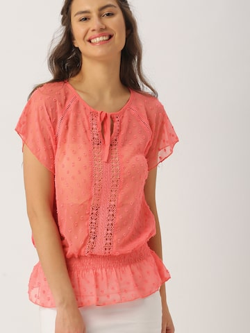 DressBerry Coral Red Self-Design Blouson Top at myntra
