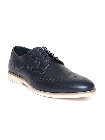 Red Tape Men Navy Leather Brogues at myntra