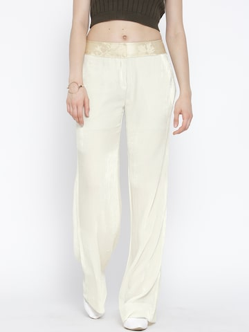 MANGO Women Cream-Coloured Loose Fit Flat-Front Trousers at myntra