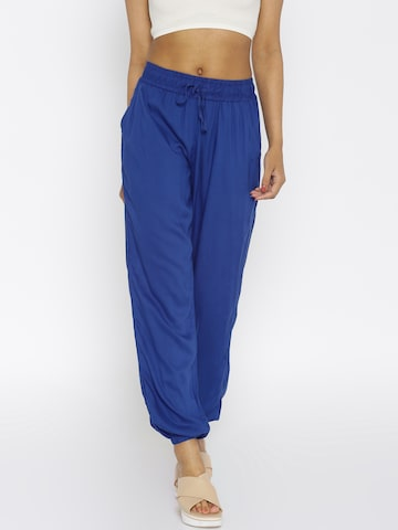 Global Desi Women Blue Solid Trousers at myntra