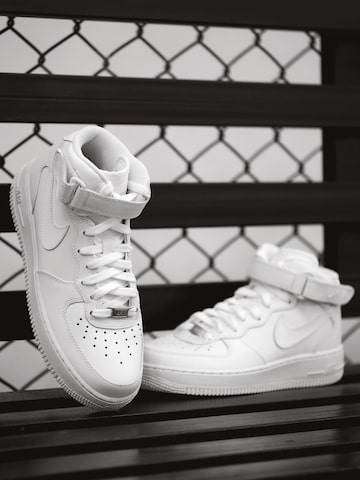 Nike Women White Solid AIR FORCE 1 '07 Mid-Top Leather Sneakers at myntra