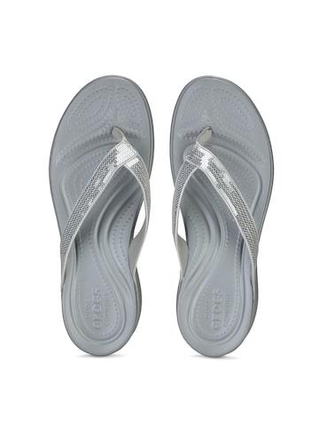 Crocs Women Silver-Toned Sequinned Flip-Flops at myntra