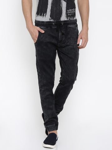 Ed Hardy Men Black Mid-Rise Clean Look Jogg Jeans at myntra