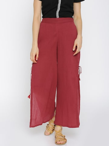 Global Desi Women Red Solid Parallel Trousers at myntra
