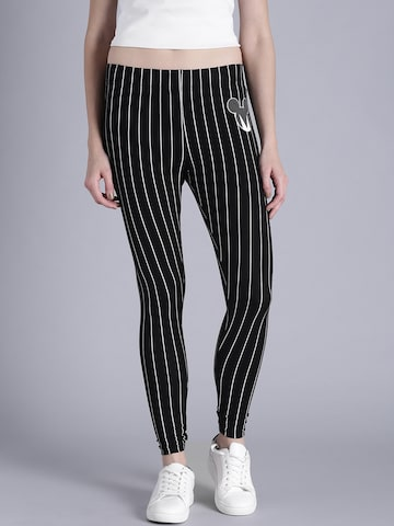 Kook N Keech Disney Women Black & White Striped Leggings at myntra