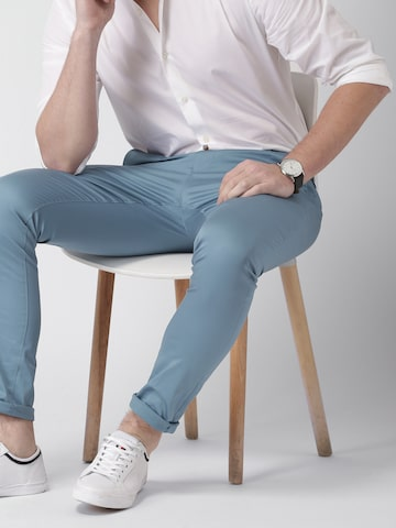 INVICTUS Men Blue Slim Fit Solid Regular Trousers INVICTUS Trousers at myntra