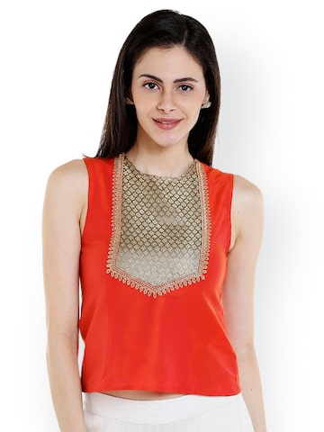 Fusion Beats Women Orange Solid Crop Top at myntra