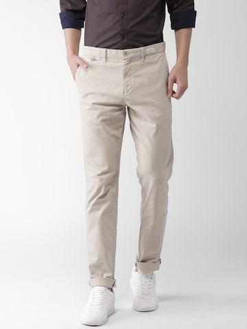 Tommy Hilfiger Men Beige Slim Fit Self-Design Chinos Tommy Hilfiger Trousers at myntra