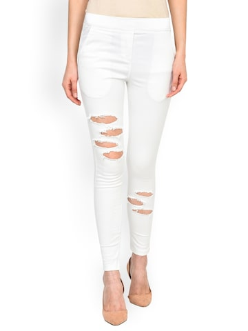 Castle White Ripped Jeggings Castle Jeggings at myntra
