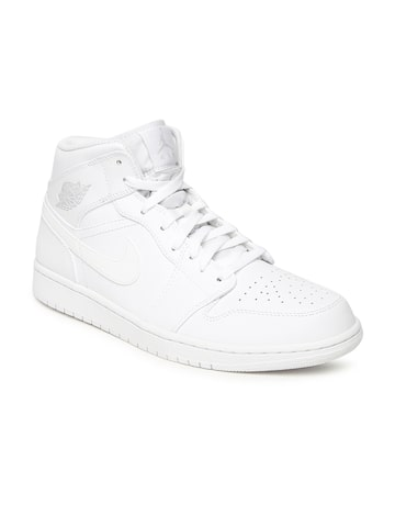 Nike Men White Leather Mid-Top AIR JORDAN 1 Basketball Shoes Nike Sports Shoes at myntra
