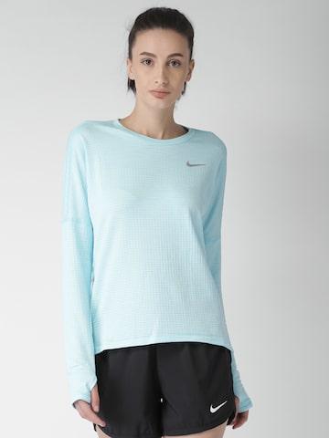Nike Women Blue Self Design AS W NK THRMA SPHR ELMNT Top Nike Tops at myntra