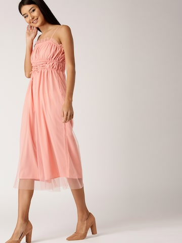 DressBerry Peach-Coloured Solid Culotte Jumpsuit DressBerry Jumpsuit at myntra