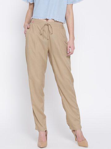 Shree Women Beige Solid Trousers Shree Trousers at myntra