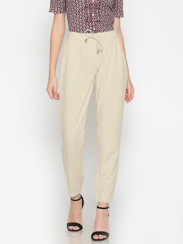 Wills Lifestyle Women Peach-Coloured Regular Fit Solid Joggers Wills Lifestyle Trousers at myntra