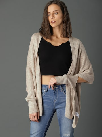 Roadster Beige Solid Open Front Shrug Roadster Shrug at myntra