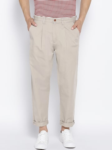 People Men Khaki Loose Fit Solid Casual Trousers People Trousers at myntra
