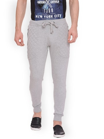 People Men Grey Regular Fit Solid Joggers People Trousers at myntra