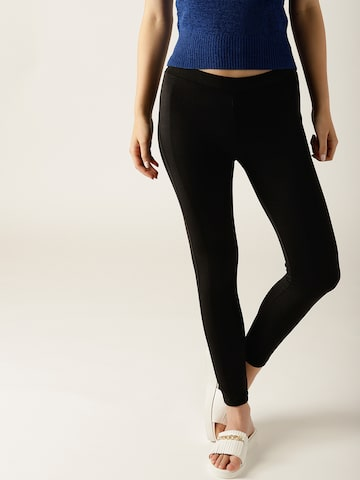 United Colors of Benetton Black Solid Treggings United Colors of Benetton Jeggings at myntra