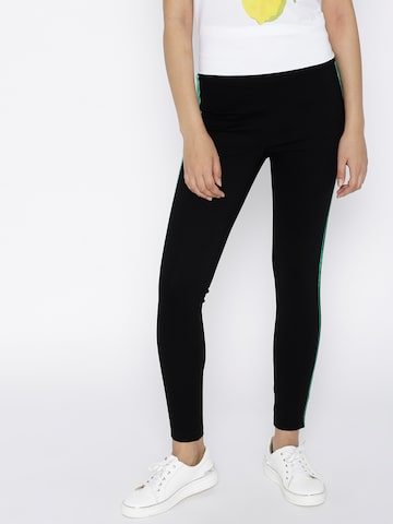 MANGO Women Black Solid Ankle-Length Leggings MANGO Leggings at myntra