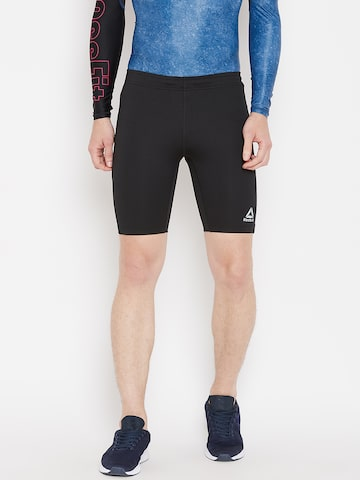 Reebok Black Run Solid Shorts Reebok Shorts at myntra