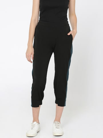 ONLY Women Black Solid Three-Fourth Treggings ONLY Jeggings at myntra
